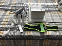 Wii with fit board and 9 games!
