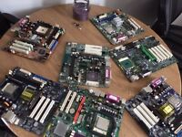 Job lot of motherboards and processors.