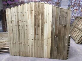 Omega top feather edge fence panels pressure treated green
