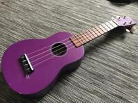 Purple ukulele by Ariana