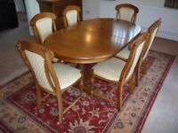 Dining table, chairs, and matching sideboard. Solid oak.