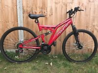 Used - Red Maxima Tornado mountain bike for kids with lock