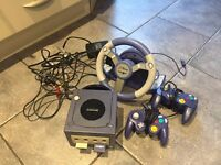 Nintendo Gamecube with controllers and wheel controller