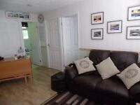 2 bed hol chalet in Bude cornwall/devon set in manor house grounds sleeps 5 allows dogs