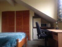 large room in family home-ten mins from city, close to hospital, universities and station.