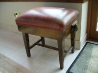 Vintage piano stool with leather seat