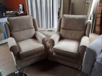 2 cream material arm chairs brand new . must go £25 each