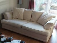 Two 3 seater cushion backed sofas.