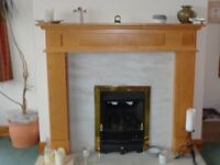 Pine fire surround, excellent condition. Very easy to install and ready for collection.