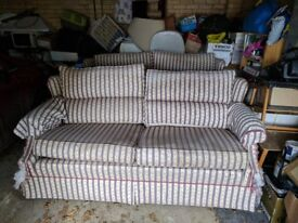 2 cream patterned sofas in need of recovering