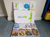 Nintendo Wii Console, Wii fit Board, Guitar, 11 games and accessories