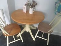 Dining table and two chairs, solid wood and great quality