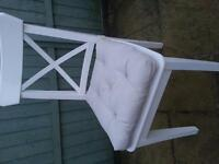 white solid chair and cushion