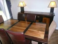 Beautiful solid wood dining suite. Table, 6 chairs, Sideboard and matching lamps