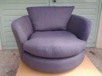 Designer swivel sofa chair