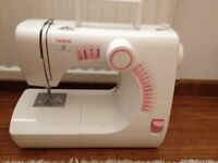 TOYOTA SEWING MACHINE SE13RS2000 with a sewing box