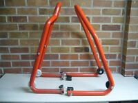 A set front and rear motorcycle paddock stands