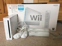 Nintendo Wii boxed, two controllers and nunchuk controllers Wii sports included