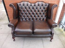 A Dark Brown Queen Ann Leather Chesterfield Two Seater Sofa