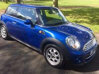 Mini Cooper Automatic, very low mileage, metallic blue, excellent condition