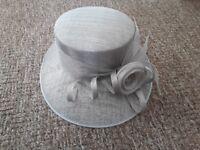 Silver grey wide brimmed hat.