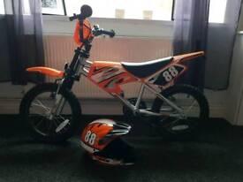 Boys 16 inch mxr450 bike with helmet