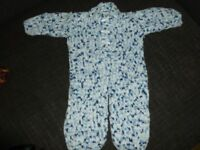 Lovely soft hand knitted baby all in one suit