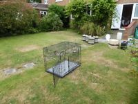 """Large dog cage. Size 24""""x 34""""x 27.5"""" up. Lies flat to 4"""" when collapsed. Very good condition"""