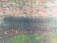 Four original cast iron railings