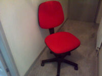 Red and Black Swivel Chair.