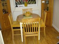 Extendable oak dining table and four chairs