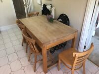 Solid wood table with side drawers on each side and 4 chairs