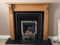 Gas fire, black slate hearth and wooden surround