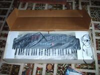 Genexxa PK-210 full size personal keyboard, boxed. Bought from Tandy, with instructions