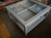 Ikea grey coffee table with glass and stporage.