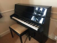 Young Chang black gloss piano excellent condition. Comes with piano stool