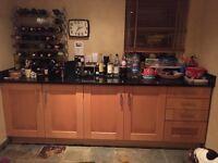 Modern kitchen with black granite worktops
