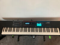 Roland Juno DS-88 synthesizer with weighted keys + stand and sustain pedal
