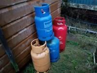 4 empty gas bottles