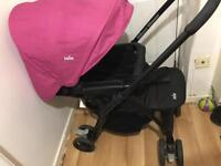 Joie pushchair with raincover.