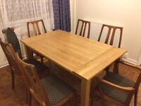 Homely Varnished Oak table with six chairs