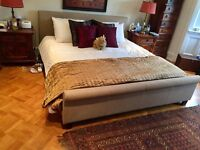 Super Kingsize bed frame, very good condition. Fabric, sleigh bed design.