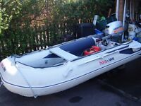 """Honwave T30 AE2 CAT """"C"""" inflatable boat with Honda 15hp four stroke engine."""
