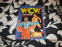 WCW OFFICIAL FACT FILE BOOK HAS SOME DAMAGE TO THE SPINE OF THE BOOK