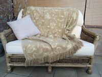 Small 2 seater cane conservatory sofa.