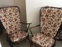 Pair of vintage dark wood Ercol armchairs in need of restoration