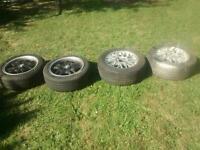Four BMW five stud alloy wheels