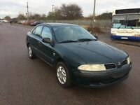 LEFT HAND DRIVE MITSUBISHI CHARISMA, DRIVES VERY WELL,ENGINE & MECHANICS,PAPERS SORTED.CALL ME