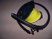 black and yellow foot pump