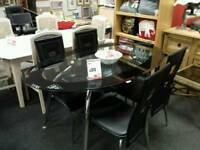 Lovely black glass table and chairs